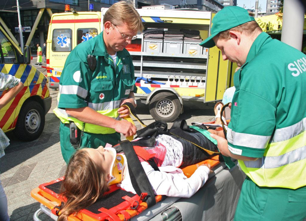Demonstration of ambulance personnel emergency medical services for children prepare to save injured kids