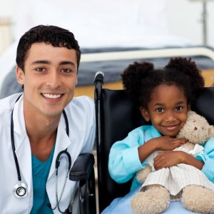 doc dr doctor with child kid wheelchair pediatric trauma patient injury emergency