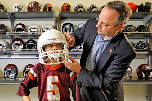 Stefan Duma youth football helmet safety concussion traumatic brain injury TBI