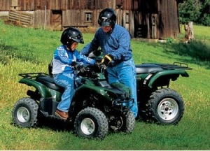 man with child riding ATVs all terrain vehicles outdoor recreation prevent injury