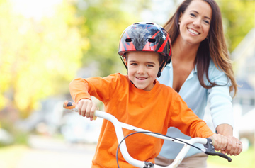 kid riding bike with helmet mom safety