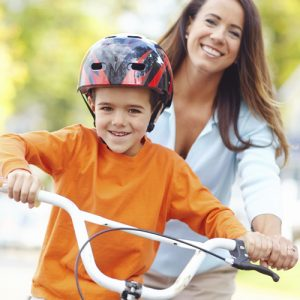 mom and kid on bike helmet safety prevention