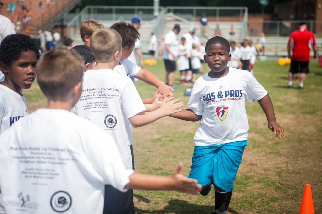 Heads Up youth football safety clinic kids and pros