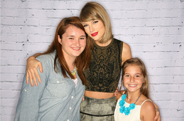 Pediatric trauma survivors, Meredith (left) and Weezie (right) with Taylor Swift